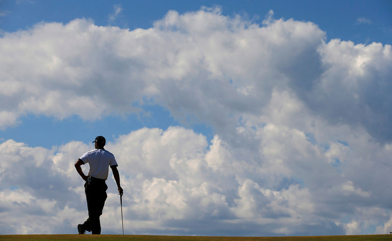 . Tiger Woods of the U.S. waits to putt on the fourth green during the first round of the British Open golf championship at Muirfield in Scotland July 18, 2013.  REUTERS/Brian Snyder