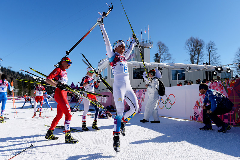 . Silver medalist Charlotte Kalla of Sweden celebrates after the Ladies\' Skiathlon 7.5 km Classic + 7.5 km Free during day one of the Sochi 2014 Winter Olympics at Laura Cross-country Ski & Biathlon Center on February 8, 2014 in Sochi, Russia.  (Photo by Harry How/Getty Images)