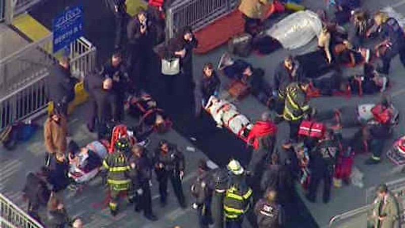 . This aerial photo provided by WABC News Channel 7 shows emergency personnel at the scene of a ferry crash in Lower Manhattan, Wednesday, Jan. 9, 2013, in New York. The Fire Department says at least 50 people were injured when a ferry from New Jersey struck a dock during rush hour. (AP Photo/WABC News Channel 7)