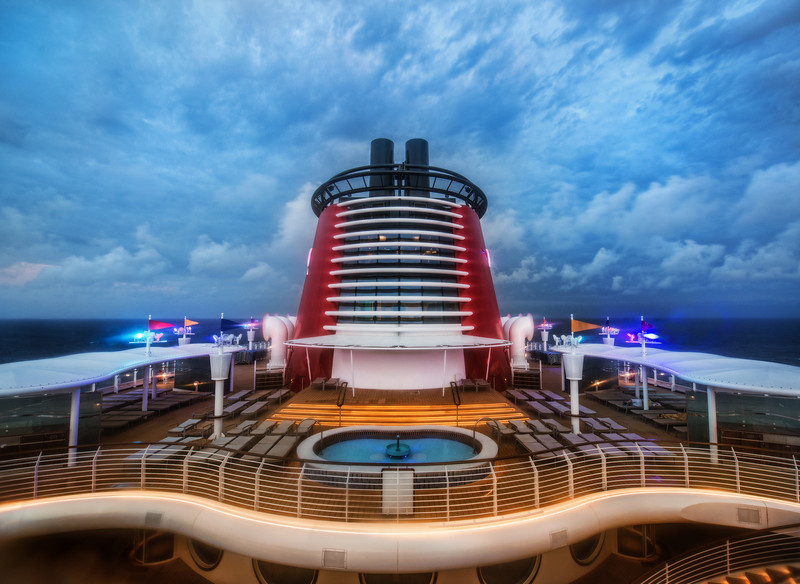 """On Top of the Disney Fantasy This was my first Disney cruise, so I don't know if I was lucky with the clouds, or if they are usually full of oceanic-drama. I know some of you in the audience are big ocean-sailing-boat people, so you would know… What you see here is one of the """"Adult Only"""" areas of the ship. I was surprised that there were many of these areas spread around, and at least three pools just for grown-ups. It was a nice surprise! - Trey RatcliffClick here to read the rest of this post at the Stuck in Customs blog."""