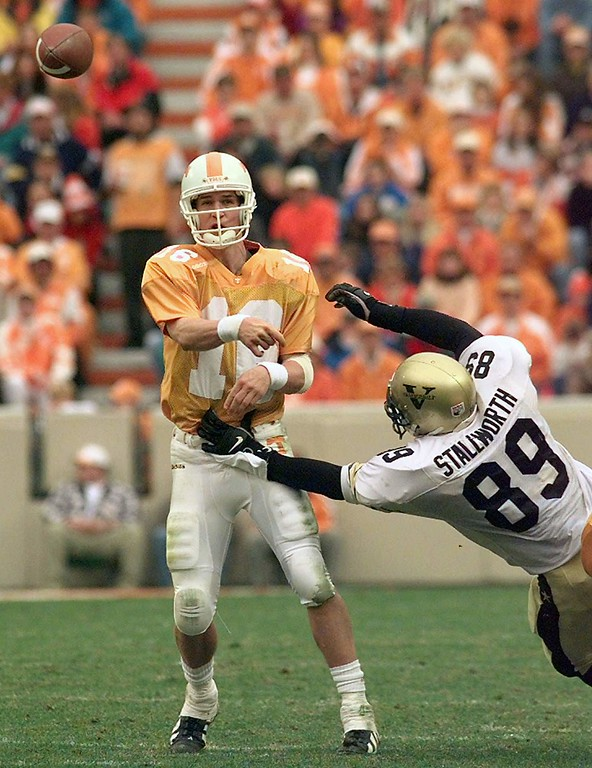 . Tennessee quarterback Peyton Manning  (16) gets a pass off despite the pressure put on him by Vanderbilt\'s Jay Stallworth (89) in the third quarter of Tennessee\'s 17-10 win on Saturday, Nov. 29, 1997 in Knoxville, Tenn. The Vanderbilt defense sacked Manning twice and held him to 159 yards passing, his second lowest game total for the year. (AP Photo/Mark Humphrey)