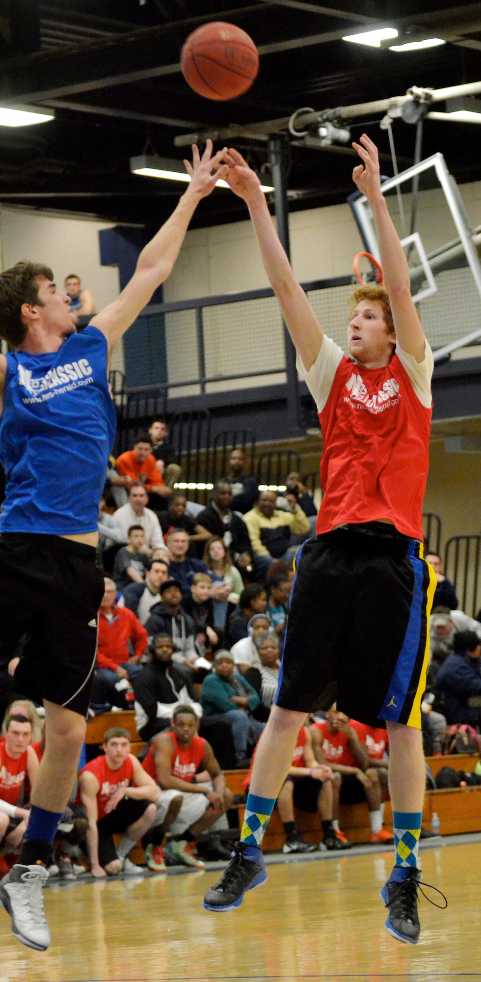 Description of . Jeff Forman/JForman@News-Herald.com John Cirillo, Red, shoots as John Dahlhausen defends during the 36th News-Herald Classic March 29 at Lakeland Community College.