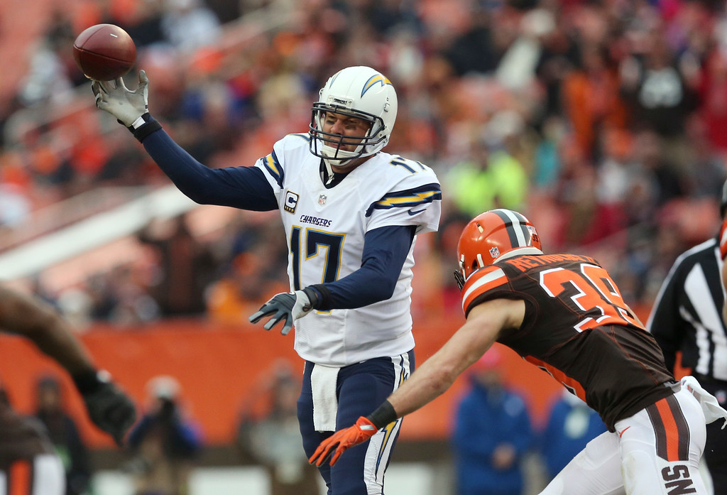 . San Diego Chargers quarterback Philip Rivers (17) throws on pressure from Cleveland Browns free safety Ed Reynolds (39) in the first half of an NFL football game, Saturday, Dec. 24, 2016, in Cleveland. (AP Photo/Aaron Josefczyk)