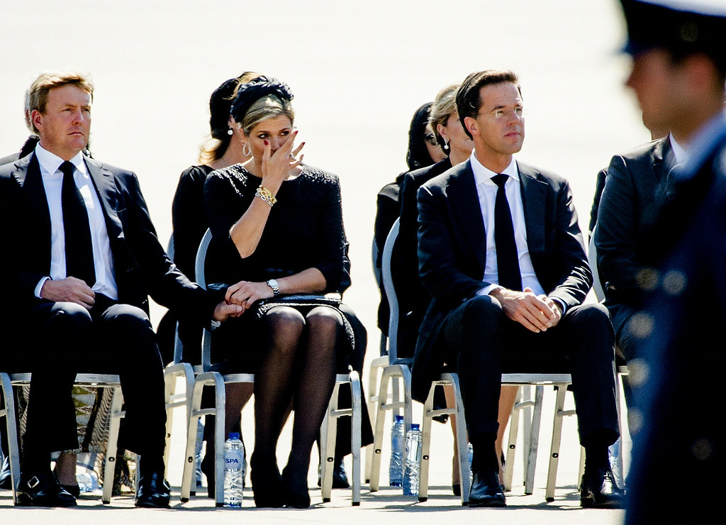 . (From L) King Willem-Alexander and Queen Maxima of The Netherlands, and Dutch Prime minister Mark Rutte attend a ceremony upon the arrivals of a plane from Ukraine, carrying the remains of victims of downed Malaysia Airlines flight MH17, at Eindhoven Airbase on July 23, 2014. The first bodies from flight MH17 arrived in the Netherlands on July 23 almost a week after it was shot down over Ukraine, with grieving relatives and the king and queen of The Netherlands solemnly receiving the as yet unidentified victims. AFP PHOTO / ANP / ROBIN VAN LONKHUIJSEN /AFP/Getty Images