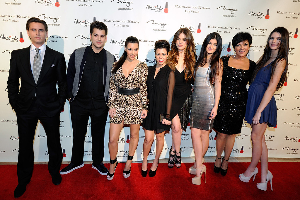 . LAS VEGAS, NV - DECEMBER 15:  (L-R) Television personalities Scott Disick, Robert Kardashian Jr., Kim Kardashian, Kourtney Kardashian, Khloe Kardashian, Kylie Jenner, Kris Jenner and Kendall Jenner arrive at the grand opening of the Kardashian Khaos store at the Mirage Hotel & Casino December 15, 2011 in Las Vegas, Nevada.  (Photo by Ethan Miller/Getty Images)