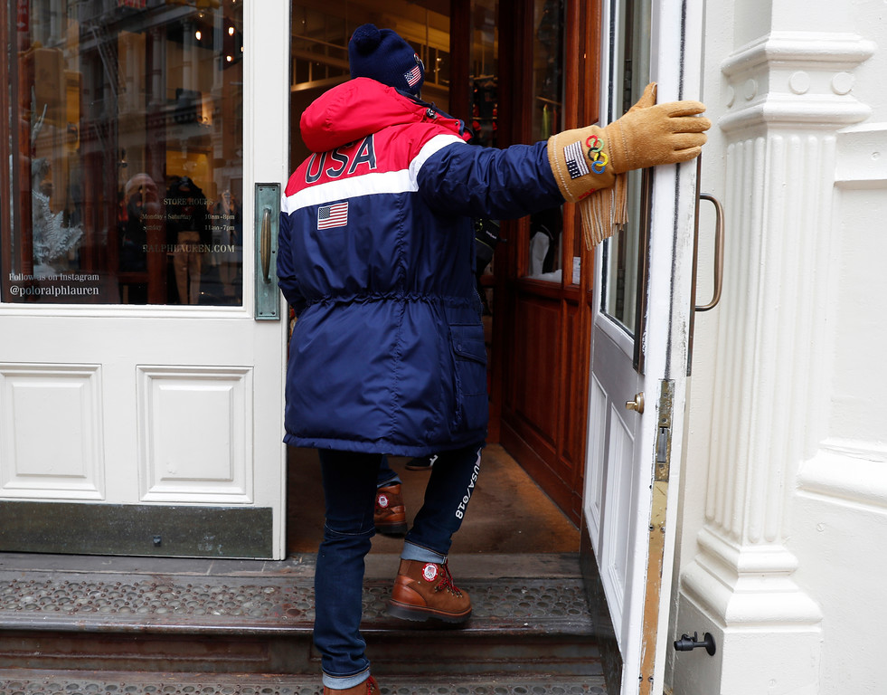 . Ice dancer Alex Shibutani walks into Ralph Lauren\'s Prince Street store after posing for photographs wearing Team USA\'s Opening Ceremony uniform designed by David Lauren, Monday, Jan. 22, 2018, in New York. (AP Photo/Kathy Willens)