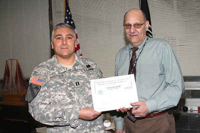 BROOKLYN - APRIL 15: Capt. Mastrota presents VA Police Chief Corselli with Certificate of Recognition.