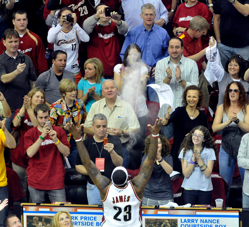 . Michael Blair/MBlair@News-Herald.com The Cavs LeBron James throws chalk dust into the air prior to the start of Saturday\'s playoff game against the Detroit Pistons.