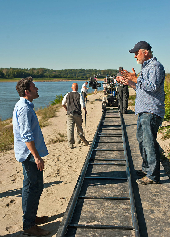 """. In this image released by 20th Century Fox, Ben Affleck, left, rehearses a scene with director David Fincher on the set of \""""Gone Girl.\"""" Fincher was nominated for a Golden Globe for best director for the film on Thursday, Dec. 11, 2014. The 72nd annual Golden Globe awards will air on NBC on Sunday, Jan. 11.  (AP Photo/20th Century Fox, Merrick Morton)"""