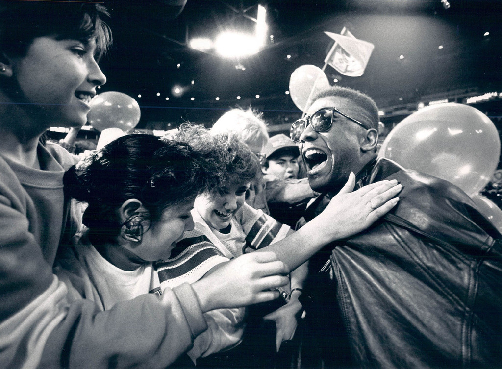 . FEB 2 1988 - Broncos homecoming party at big Mac . Player Mark Jackson ran up to the crowd for hugs and kisses. (Lyn Alweis/The Denver Post)