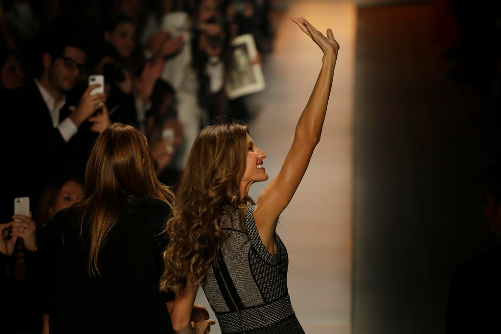 . Brazilian top model Gisele Bundchen waves at the end of Colcci winter collection show during the Sao Paulo Fashion Week in Sao Paulo, Brazil, Thursday, Oct. 31, 2013. (AP Photo/Nelson Antoine)