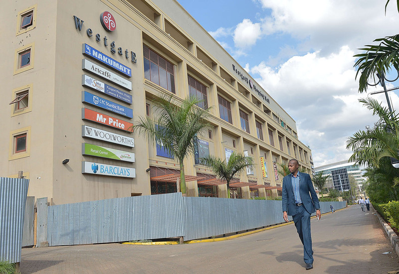 """. Ben Mulwa, 32, walks past the upmarket  Westgate mall  on September 10, 2014 where he was shot in the leg as he arrived at the upmarket Westgate shopping mall where 67 people were massacred, a year ago on September 21, during a gun attack claimed by Somalia\'s islamists, al-Shebab. \""""It was a miracle how I survived,\"""", says Mulwa who adds, \""""That attack alone changed my life. To date, every time I hear the sound of a gunshot, it messes me up,\"""" said the father-of-two, who is involved in micro-finance projects supporting poor women and youth.  TONY KARUMBA/AFP/Getty Images"""