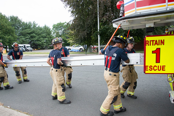08/05/19 Wesley Bunnell | Staff New Britain firefighters load a ladder back on engine 1 on Tuesday afternoon after a training exercise outside of the Linda Blogoslawski Parking Garage.