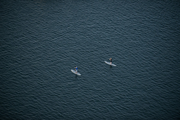 Jay and Deanne paddleboarding seen from above