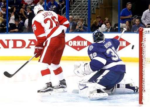 . Tampa Bay Lightning goalie Ben Bishop (30) gives up a goal to Detroit Red Wings\' Pavel Datsyuk as he is screened by Red Wings right wing Tomas Jurco (26) during the second period in Game 1 of an NHL hockey first-round playoff series, Thursday, April 16, 2015, in Tampa, Fla. (Dirk Shadd/Tampa Bay Times via AP)