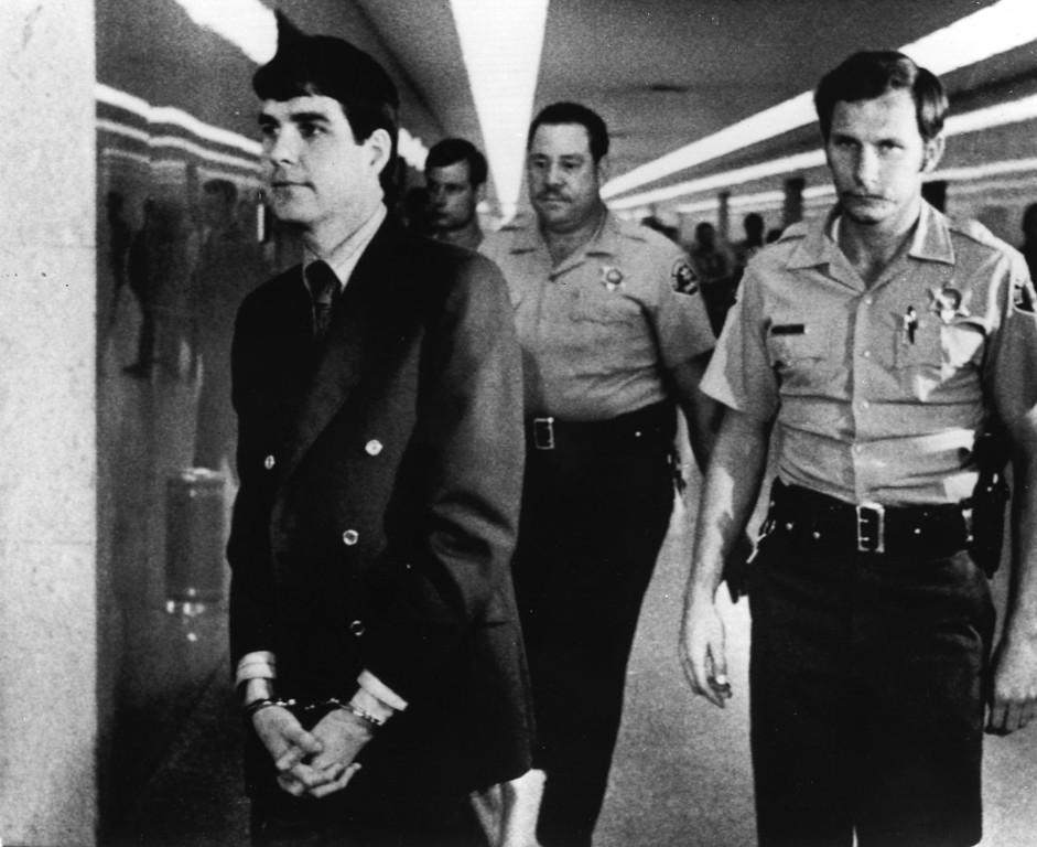 """. Charles \""""Tex\"""" Watson is led back to jail from a courtroom in Los Angeles, Oct. 12, 1971, after he was convicted of seven counts of first-degree murder and one of conspiracy to commit murder in the Tate-LaBianca slayings. Watson, a  member of the Charles Manson \""""family,\"""" was the last of five defendants to be convicted in the slayings. (AP-Photo)"""