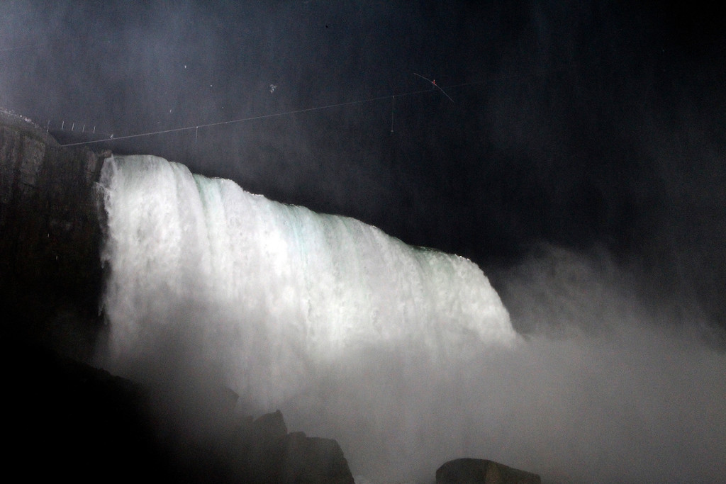 . Nik Wallenda walks across Niagara Falls on a tightrope in Niagara Falls, N.Y., Friday, June 15, 2012. (AP Photo/James P. McCoy)