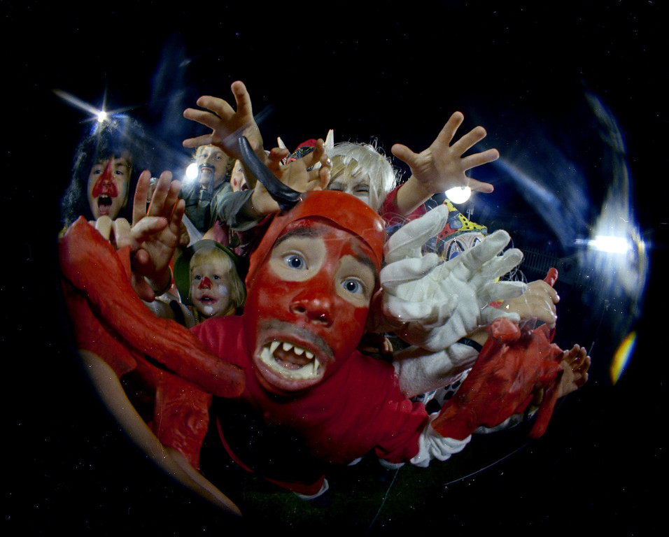 . Kids in Halloween costumes are seen through a fisheye lens, Oct. 31, 1966. Location is unknown. (AP Photo)