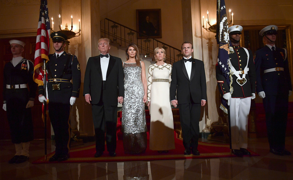 . President Donald Trump, first lady Melania Trump, Brigitte Macron, and French President Emmanuel Macron pose for a photo in Grand Foyer before a State Dinner at the White House in Washington, Tuesday, April 24, 2018. (AP Photo/Susan Walsh)