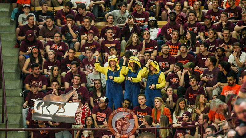 A trio of fans dressed as minions stand in the student section as halftime winds down. (Mark Umansky/TheKeyPlay.com)