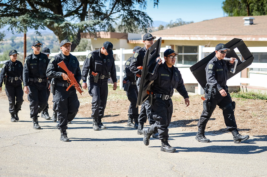 """. Explorers from Bell move in to take part in a felony arrest drill at Pitches Detention Center Sunday.  Law enforcement explorer posts participated in a weekend-long competition to sharpen their skills.  During team events such as \""""prowler\"""", \""""felony stop\"""", \""""active shooter\"""" and \""""mud Race\"""", explorers were graded on their skills in each of the tests.  Photo by David Crane/Staff Photographer"""