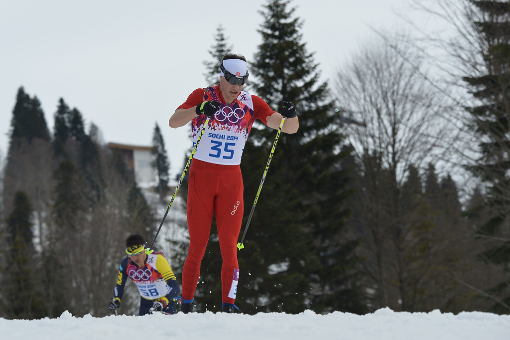 . Gold medalist Switzerland\'s Dario Cologna competes in the Men\'s Cross-Country Skiing 15km Classic at the Laura Cross-Country Ski and Biathlon Center during the Sochi Winter Olympics on February 14, 2014 in Rosa Khutor near Sochi. AFP PHOTO / ALBERTO PIZZOLI/AFP/Getty Images