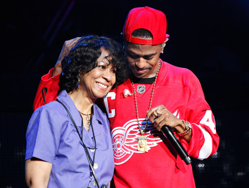 . Big Sean on stage with his mother at DTE Energy Music Theatre on Saturday, Aug. 31, 2013. Photo by Ken Settle