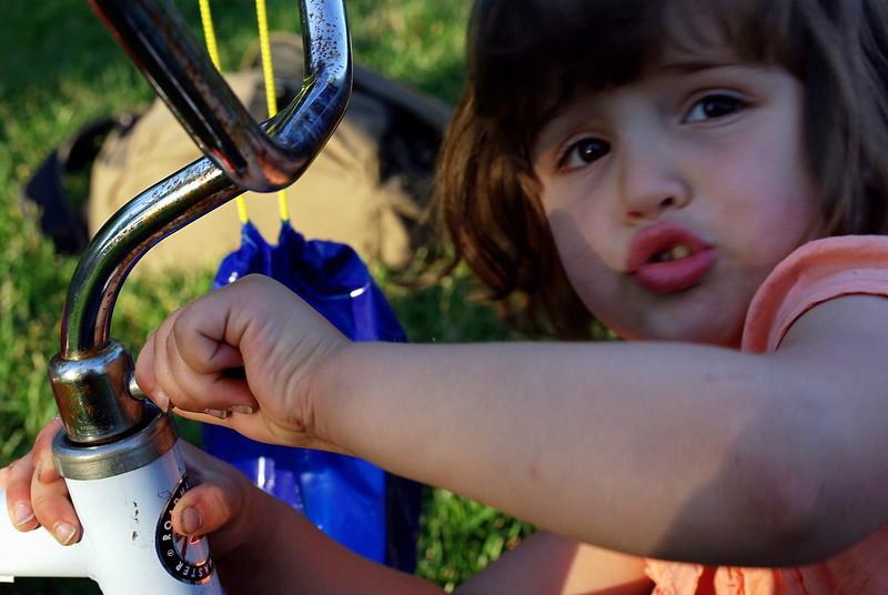 Guen works at repairing her trike.