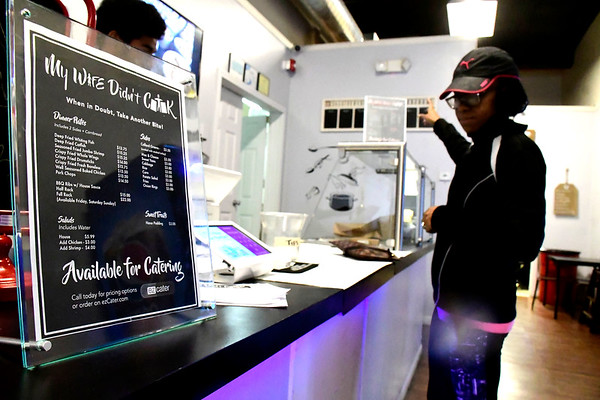 4/9/2020 Mike Orazzi | Staff My Wife Didn't Cook's Amir noble takes a food order from Shenice Brainbridge in New Britain on Thursday.