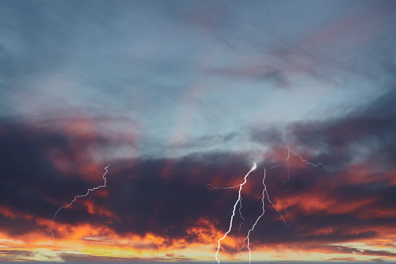 Dramatic Sunset with Blazing Red sky and Ribbon Lightning.