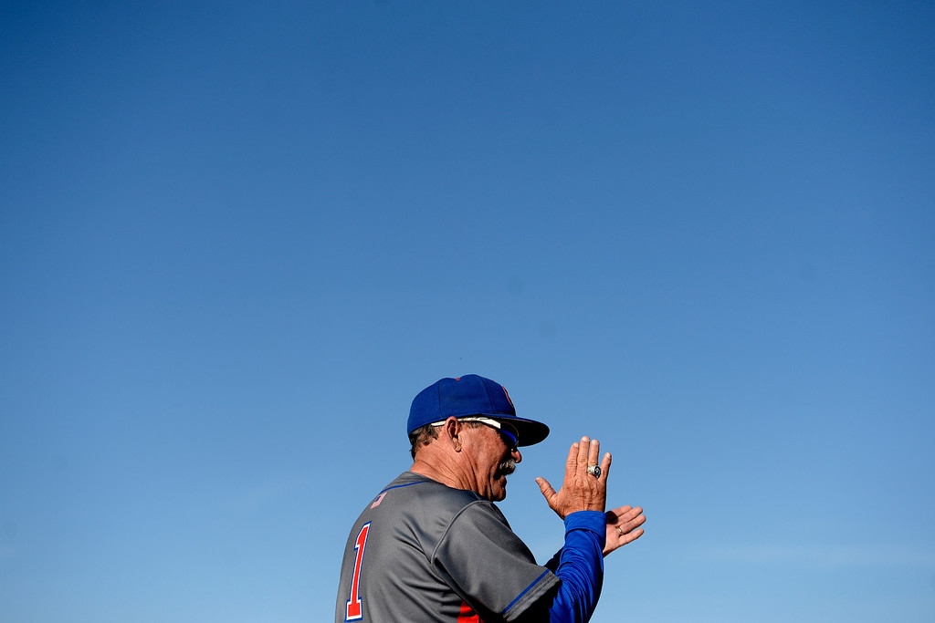 . Aurora, CO - APRIL 08: Head coach Marc Johnson of the Cherry Creek Bruins watches the action against the Overland Trailblazers during the third inning. Overland hosted Cherry Creek on Tuesday, April 8, 2014. (Photo by AAron Ontiveroz/The Denver Post)