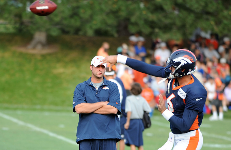 . Broncos quarterback Brock Osweiler works on throwing mechanics for quarterbacks coach Adam Gase at the beginning of practice Thursday morning, August 16, 2012. Steve Nehf, The Denver Post