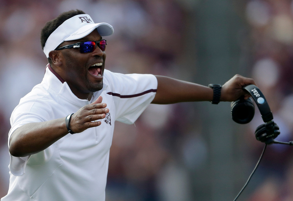 . Texas A&M head coach Kevin Sumlin celebrates after a touchdown against Alabama during the fourth quarter of an NCAA college football game Saturday, Sept. 14, 2013, in College Station, Texas. (AP Photo/David J. Phillip)