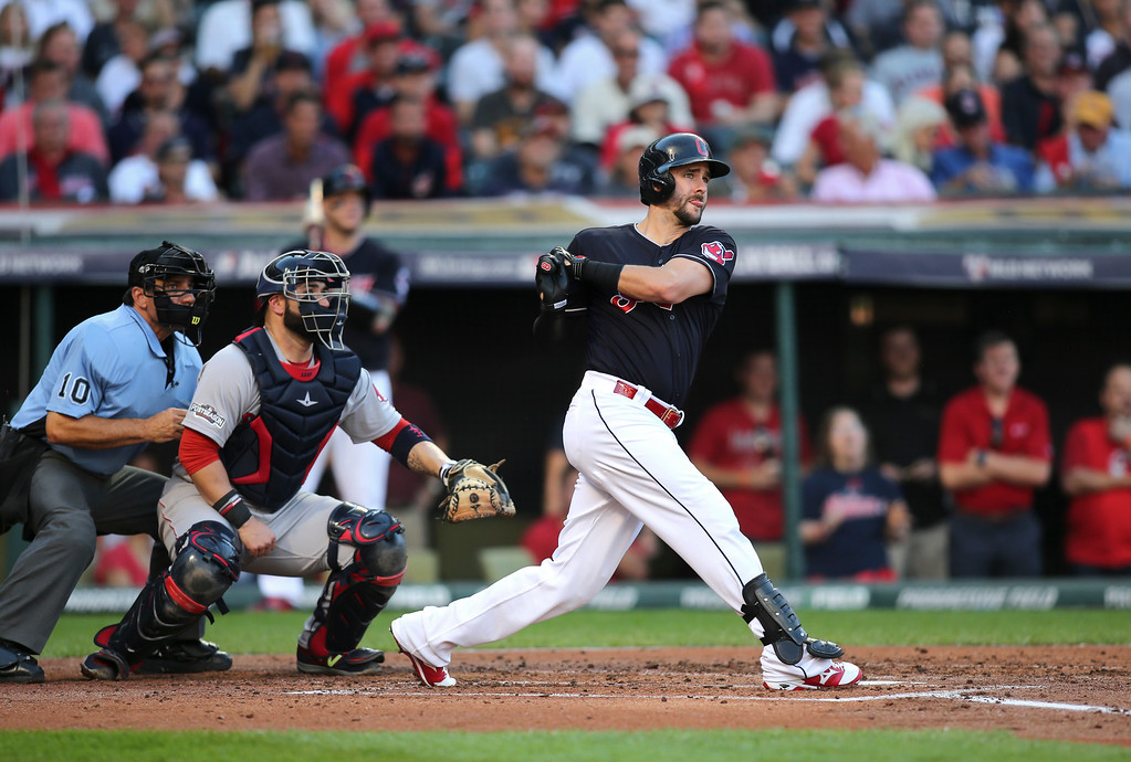 . Cleveland Indians\' Lonnie Chisenhall, right, hits a three-run home run against the Boston Red Sox in the second inning during Game 2 of baseball\'s American League Division Series, Friday, Oct. 7, 2016, in Cleveland. (AP Photo/Aaron Josefczyk)