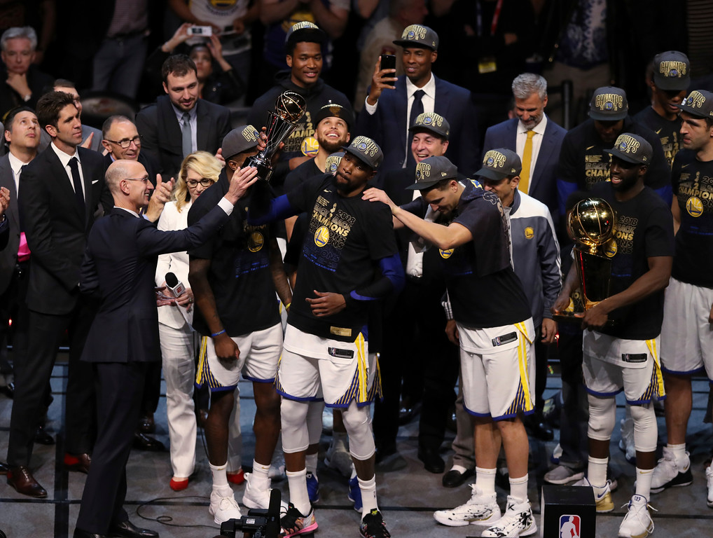 . Golden State Warriors\' Kevin Durant, middle, celebrates after the Warriors defeated the Cleveland Cavaliers 108-85 in Game 4 of basketball\'s NBA Finals to win the NBA championship, Friday, June 8, 2018, in Cleveland. (AP Photo/Carlos Osorio)