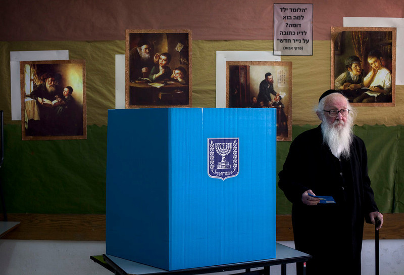 . An Ultra Orthodox Jewish man votes in Israel\'s parliamentary elections in Jerusalem, Tuesday, Jan. 22, 2013. Israelis began trickling into polling stations Tuesday morning to cast their votes in a parliamentary election expected to return Prime Minister Benjamin Netanyahu to office despite years of stalled peacemaking with the Palestinians and mounting economic troubles. (AP Photo/Sebastian Scheiner)