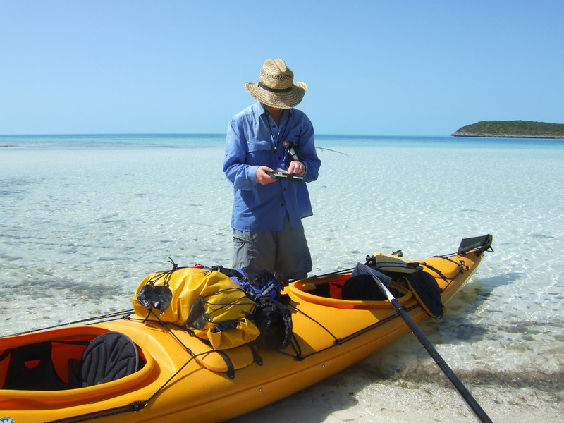 A sea kayaker selects the perfect fly for Bonefish in the Exuma Islands, Bahamas