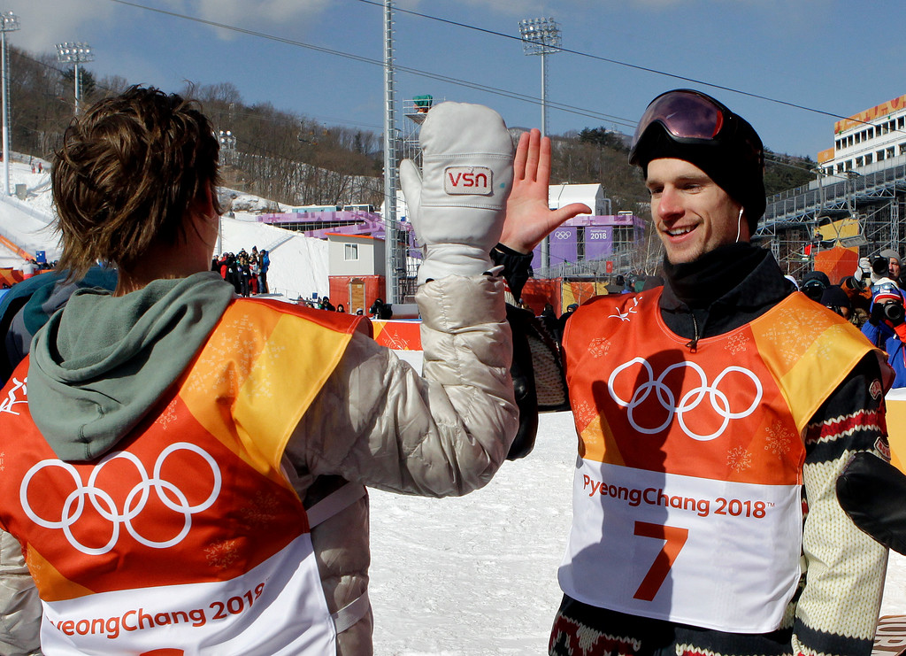 . Silver medal winner Max Parrot, of Canada, right, high fives gold medal winner Red Gerard, of the United States, after the men\'s slopestyle final at Phoenix Snow Park at the 2018 Winter Olympics in Pyeongchang, South Korea, Sunday, Feb. 11, 2018. (AP Photo/Lee Jin-man)