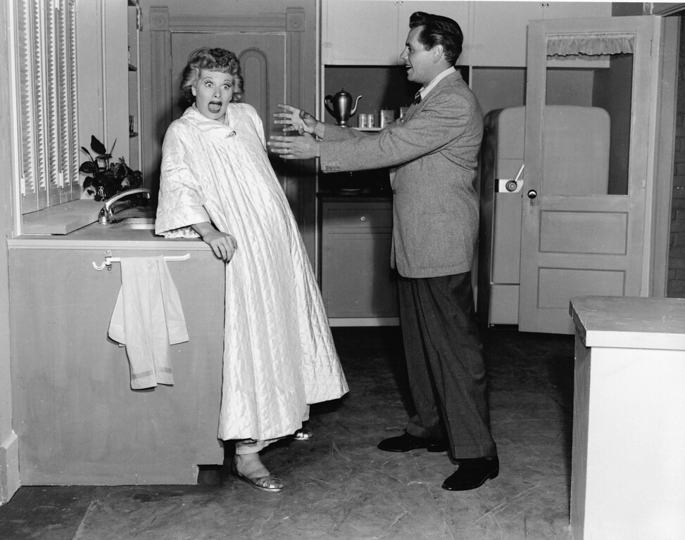 . American actor Lucille Ball (1911-1989) reacts to Cuban-born actor Desi Arnaz (1917-1986) in a still from the television show, \'I Love Lucy\', 1956. (Photo by Hulton Archive/Getty Images)