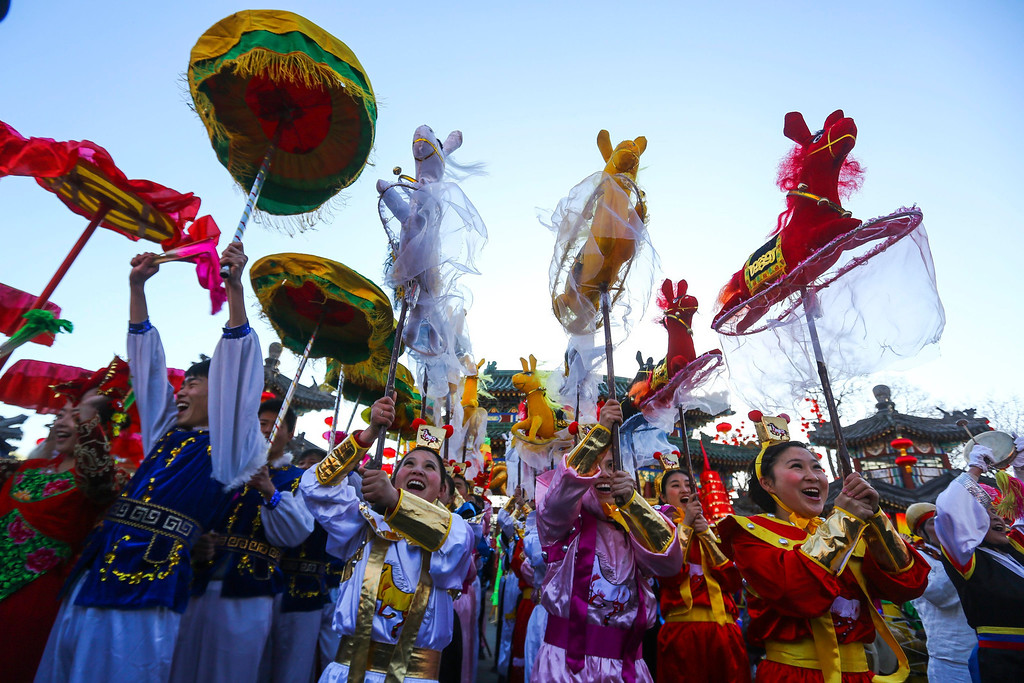 . Performers do the horse dance on the eve of the Lunar New Year, or Spring Festival, at a park fair in Beijing, China, 30 January 2014.   EPA/DIEGO AZUBEL