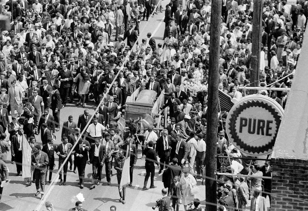 . The casket containing the body of slain civil rights leader Dr. Martin Luther King, Jr. is carried through the streets of Memphis, April 9, 1968.  (AP Photo)