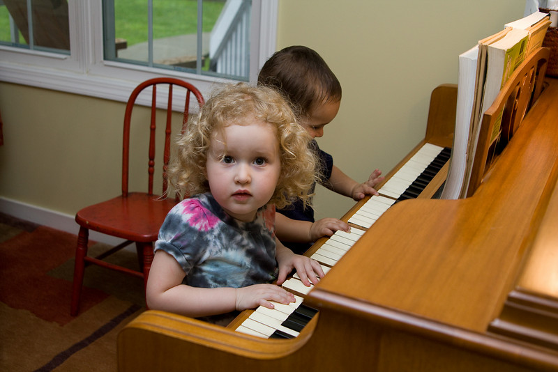 Beverly and Angelo play piano