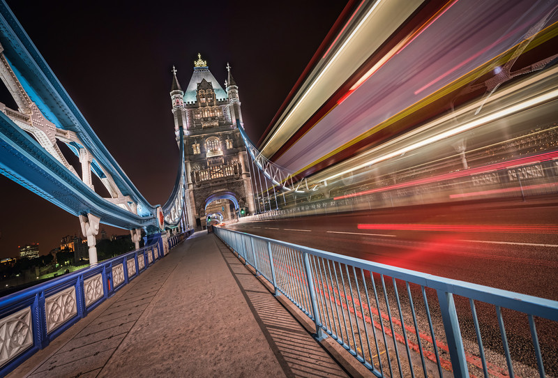 This is an HDR photo of London Tower Bridge combined with a long exposure of a  exposure of a double decker London bus passing by. Photo by Jacob Surland. See more at www.caughtinpixels.com