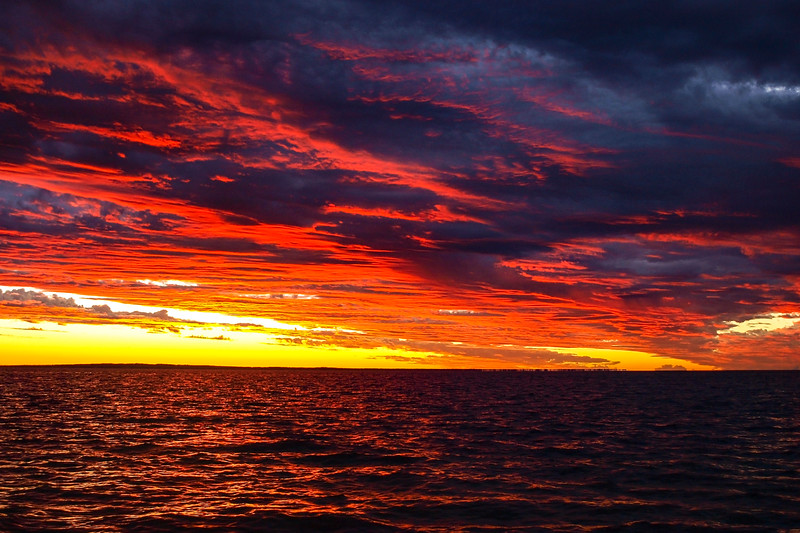 Vivid red cloudy Sunrise Seascape Australia