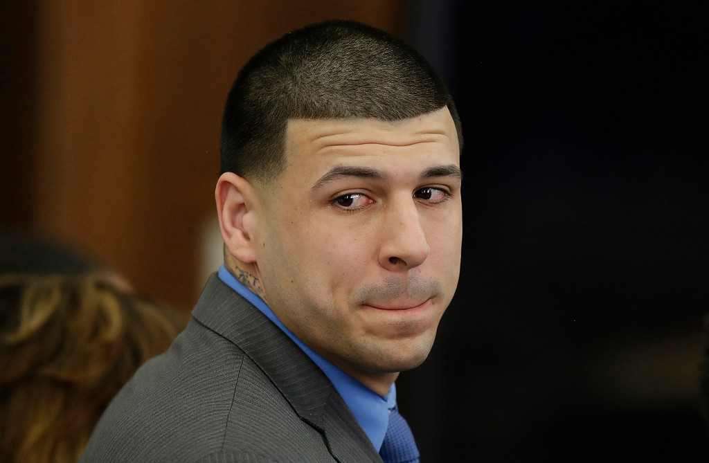 . FILE - In this April 14, 2017, file pool photo, former New England Patriots tight end Aaron Hernandez turns to look in the direction of the jury as he reacts to his double murder acquittal after the sixth day of jury deliberations at Suffolk Superior Court in Boston. Massachusetts prosecutors on Friday, June 23, 2017,  appealed a court ruling that erased the former NFL star\'s murder conviction in the 2013 killing of a semi-professional football player. Hernandez\'s conviction inwas voided after he killed himself in prison on April 19 at age 27. Under a long-held Massachusetts legal principle, courts typically erase the convictions of defendants who die before their direct appeals can be heard.  (AP Photo/Stephan Savoia, Pool, File)