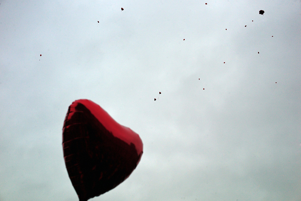 . Balloons are released during a flashmob in celebration of Valentine\'s Day, in Paris, Friday, Feb. 14, 2014. Valentine\'s Day is observed on February 14 each year as a special day to celebrate love and romance. (AP Photo/Thibault Camus)