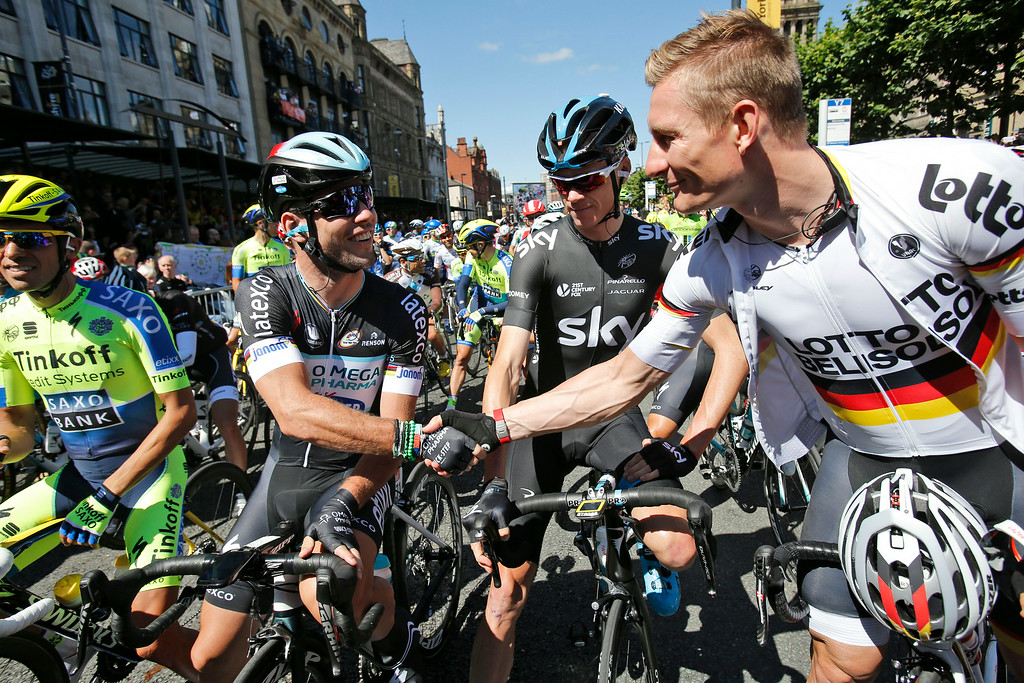 . Sprinters Mark Cavendish of Britain, second left, and Germany\'s Andre Greipel, right, shake hands as Britain\'s Christopher Froome, second right, and Spain\'s Alberto Contador, left, wait for the start of the first stage of the Tour de France cycling race over 190.5 kilometers (118.4 miles) with start in Leeds and finish in Harrogate, Britain, Saturday, July 5, 2014. (AP Photo/Christophe Ena)