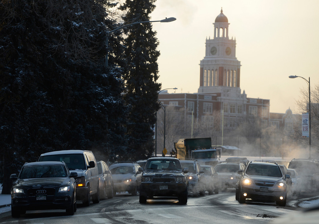 . Cars and trucks idle waiting to cross York St. at 18th Ave in below zero temperatures Wednesday morning, February 05, 2014. (Photo By Andy Cross / The Denver Post)