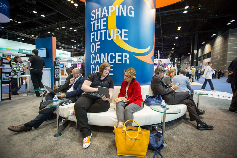 Staff provide demos to attendees and provide information about CancerLinQ during CancerLinQ Exhibit Booth