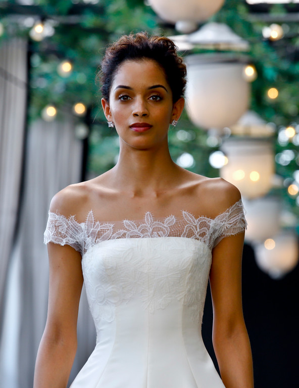 . Bridal fashion from the Amsale collection is modeled during Bridal Fashion Week, Friday April 13, 2018 in New York. (AP Photo/Bebeto Matthews)